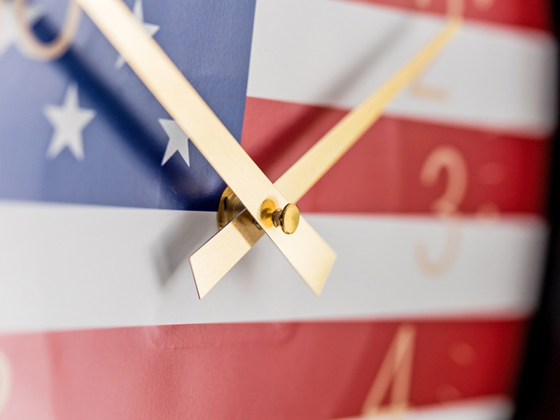 USA patriotic clock with golden clock hands